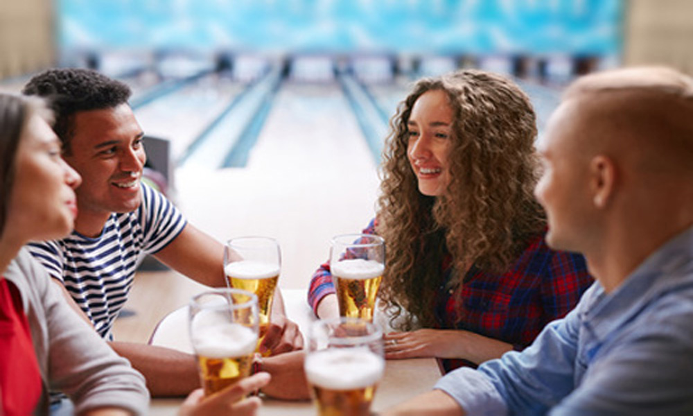couple bowling with beer